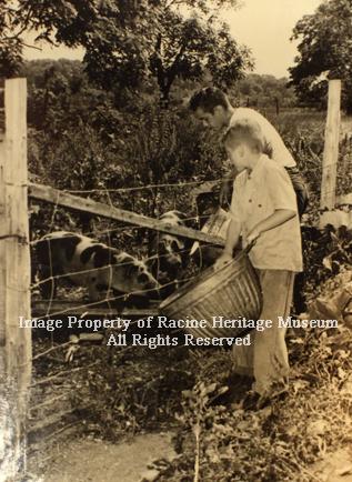 133.04 Taylor Home Children feeding pigs 300 dpi